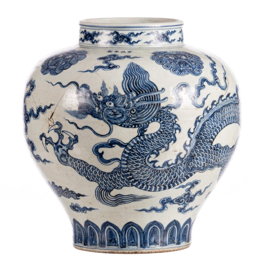 A Chinese blue and white dragon vase, marked, Qing