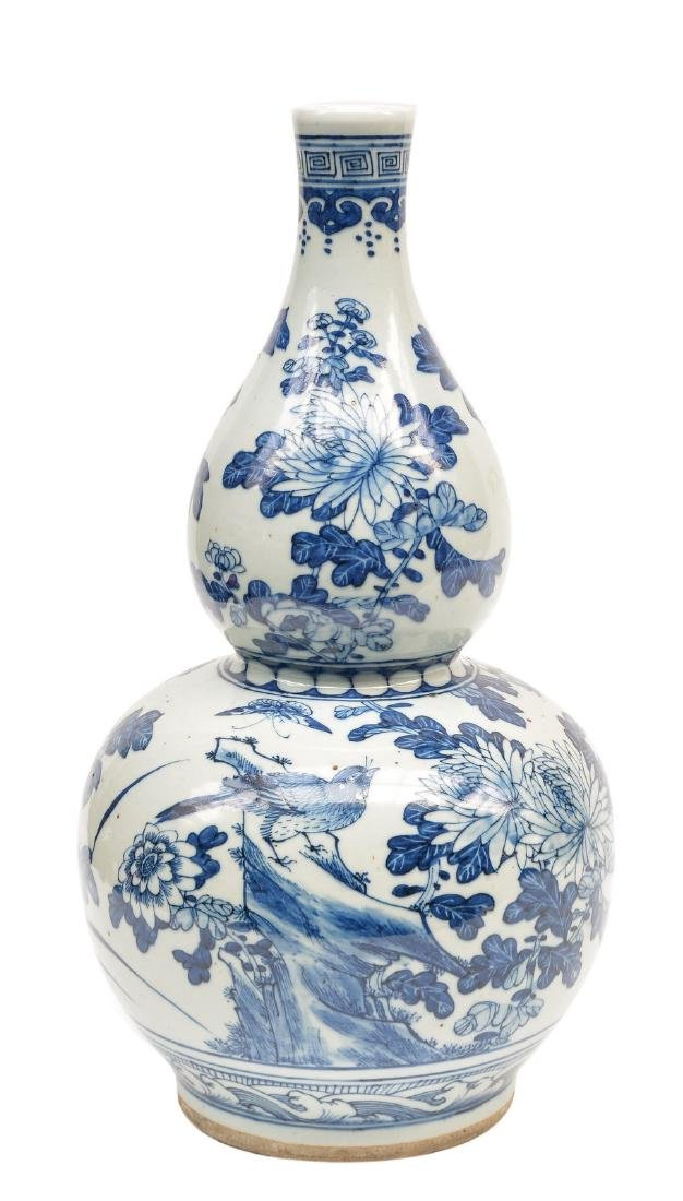A Chinese blue and white double gourd vase, 19thC, H