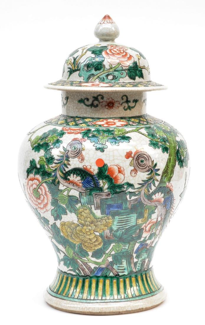 A Chinese famille verte stoneware vase with cover,