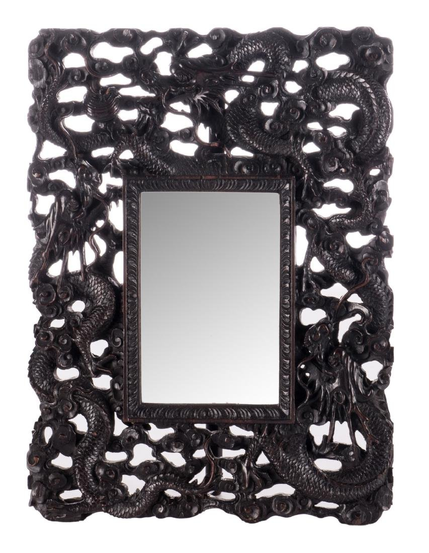 A Chinese richly carved hardwood framed mirror,