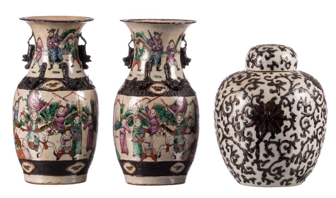 A pair of Chinese stoneware polychrome vases, decorated