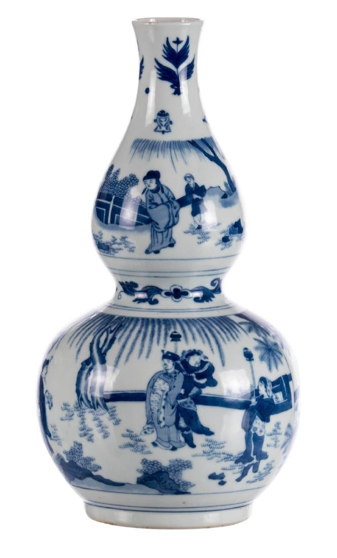 A Chinese blue and white double-gourd vase, decorated