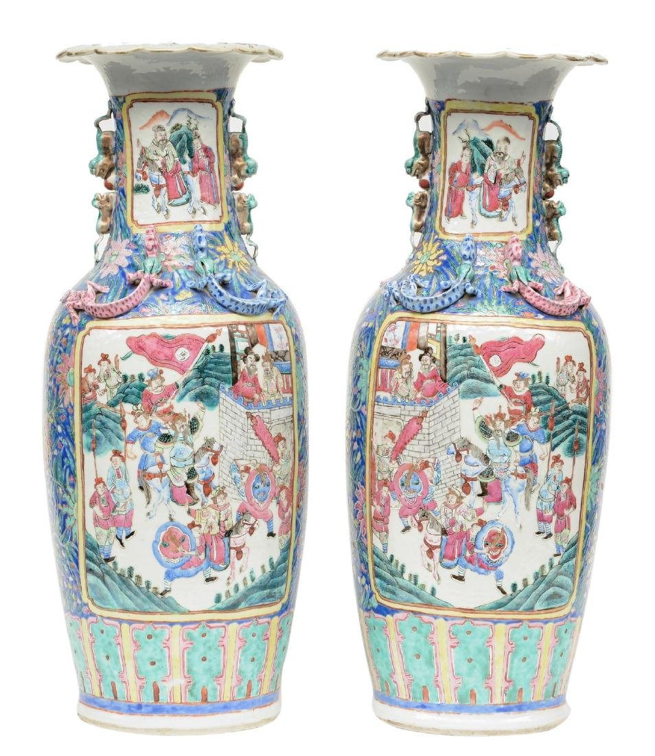 A pair of Chinese famille rose vases, decorated with a