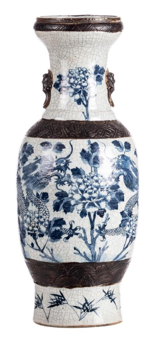 A Chinese blue and white stoneware vase, decorated with