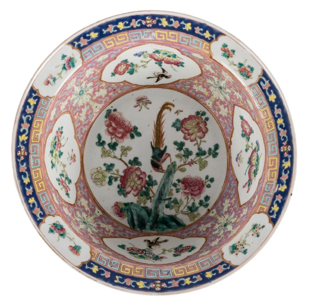 A Chinese famille rose decorated bowl, the roundels