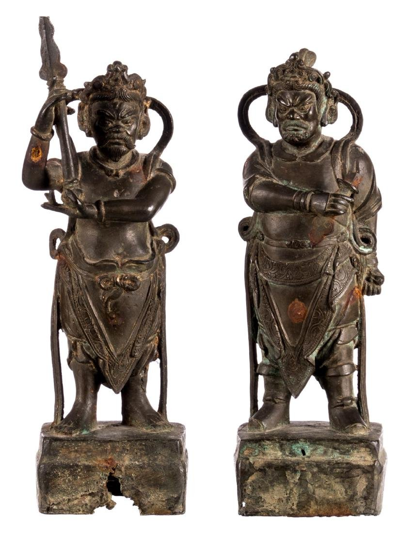Two Chinese bronze temple guards, Ming, with traces of
