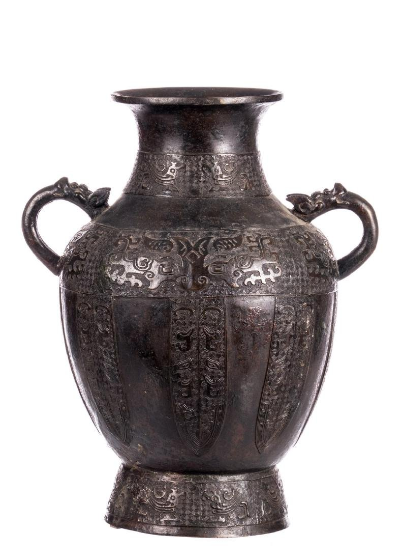 A Chinese archaic bronze vase, relief decorated with