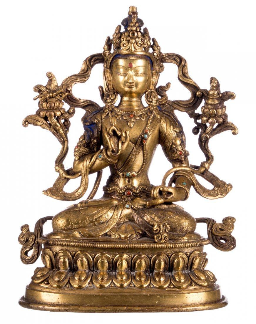 A Tibetan polychrome and gilt bronze seated Buddha with