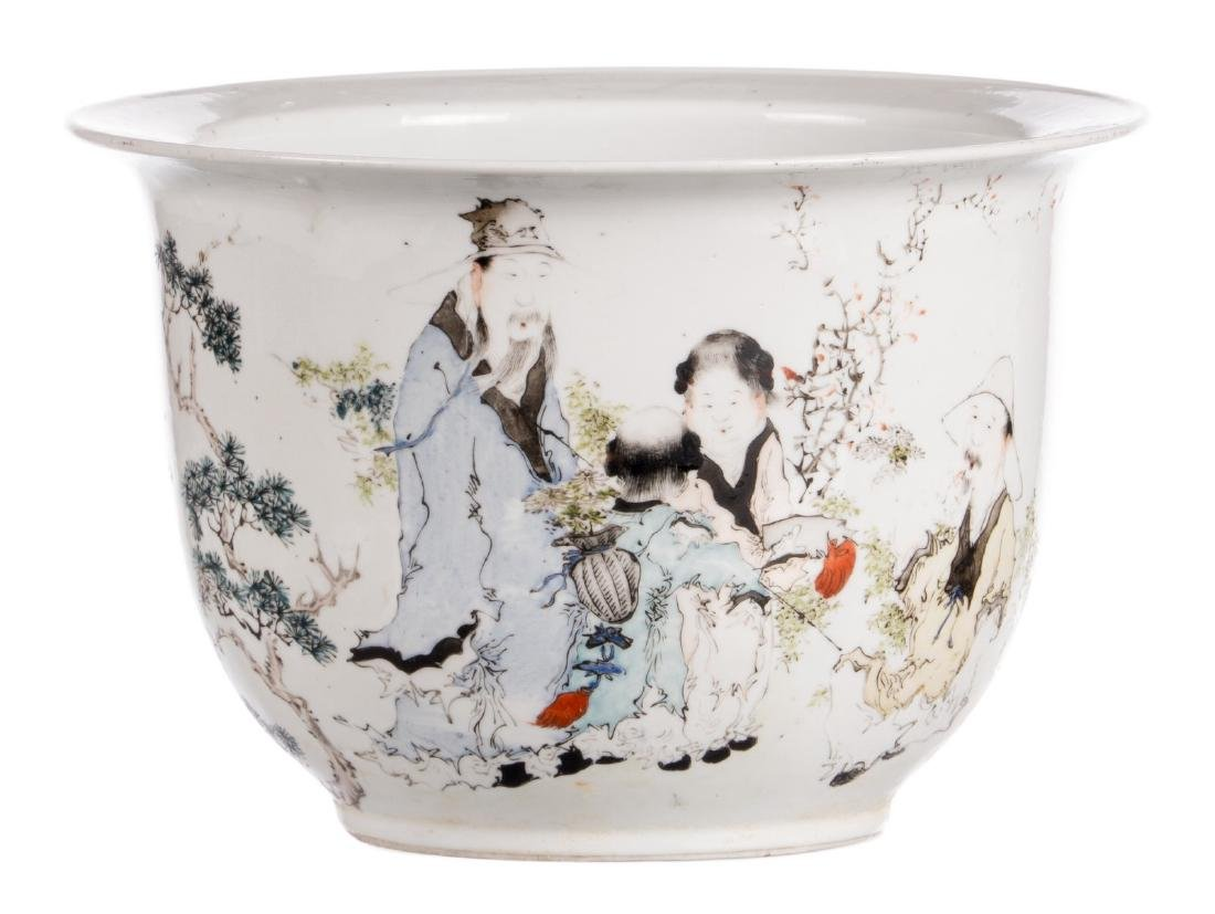 A Chinese polychrome decorated cache-pot with an