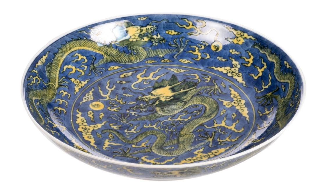 A Chinese blue and yellow glazed dish, decorated with - 2