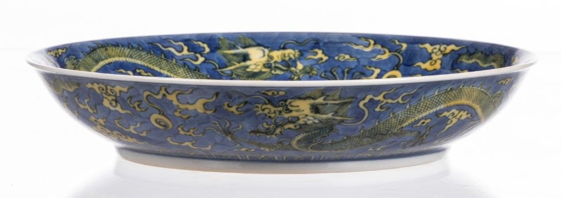 A Chinese blue and yellow glazed dish, decorated with - 5