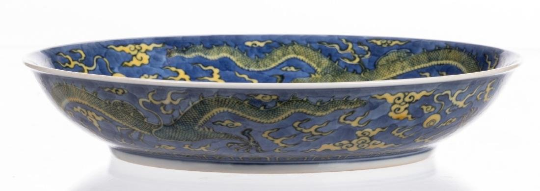 A Chinese blue and yellow glazed dish, decorated with - 6