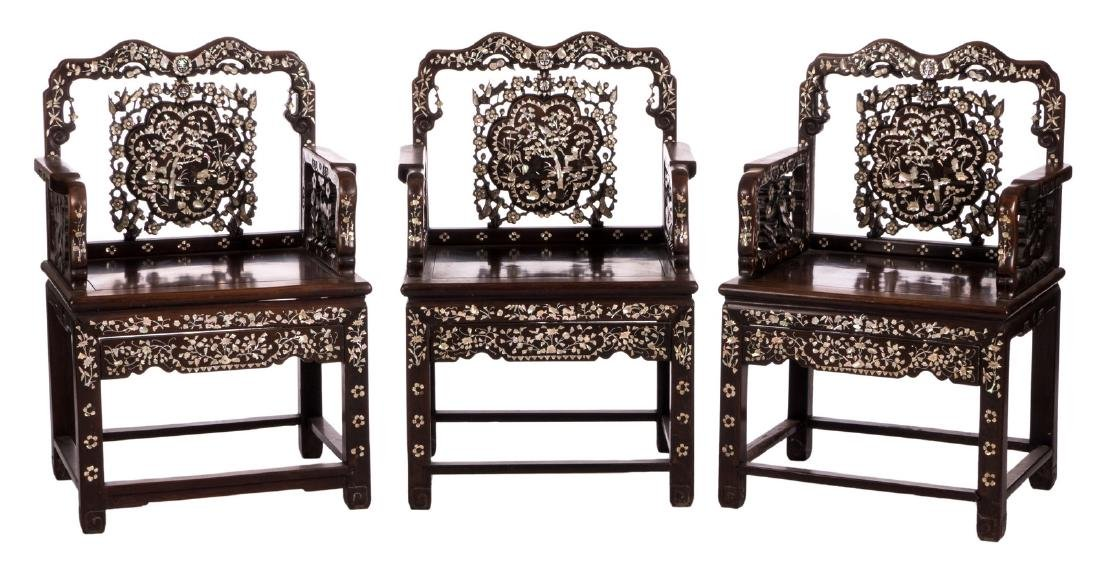 Three Chinese carved hardwood armchairs with