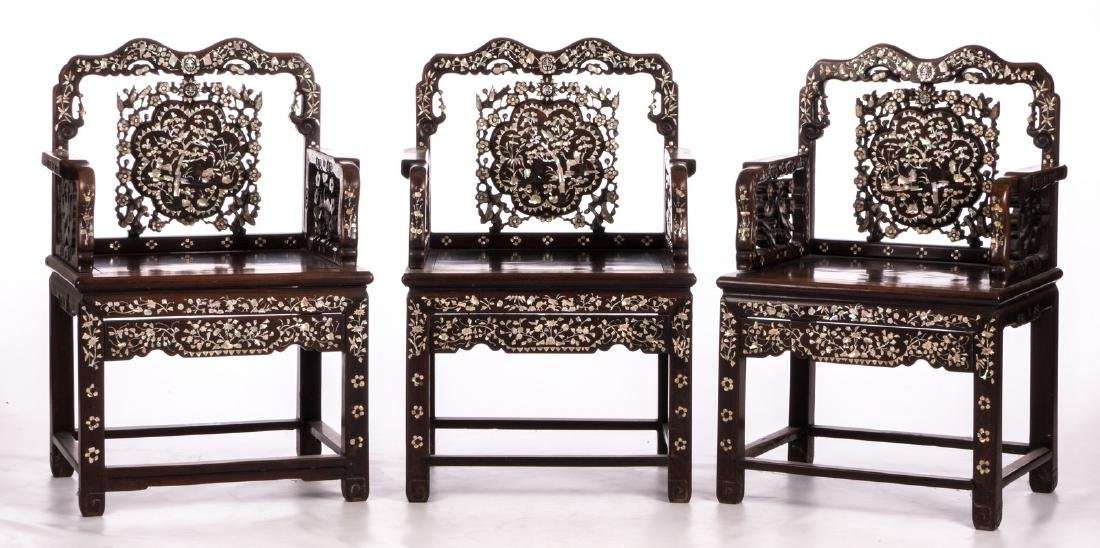 Three Chinese carved hardwood armchairs with - 2