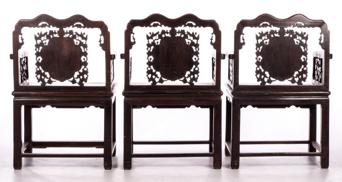 Three Chinese carved hardwood armchairs with - 4
