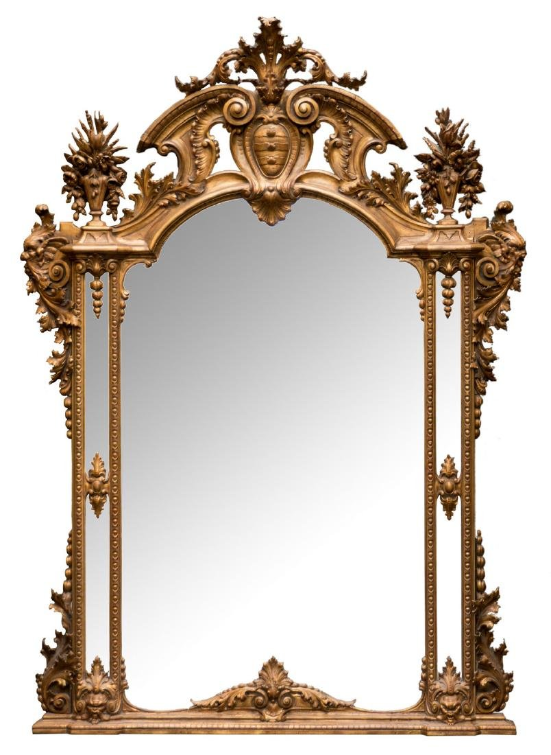 An exceptional 19thC wall mirror in carved and gilt