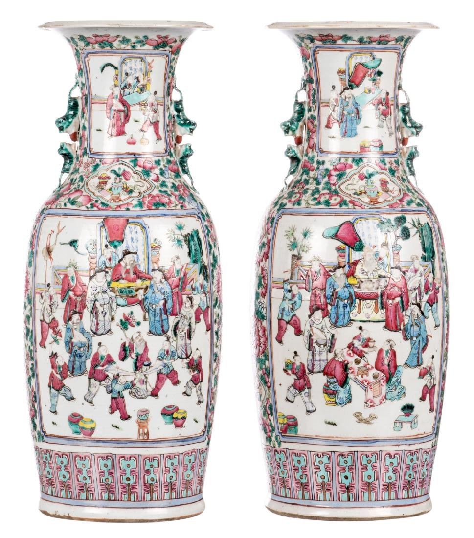A pair of Chinese famille rose vases, decorated with