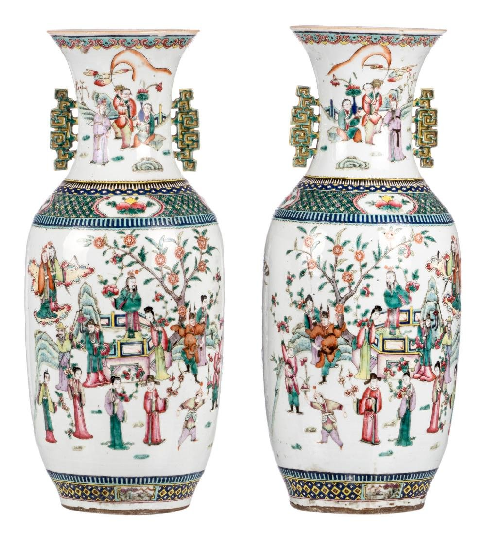 A pair of Chinese famille rose vases, decorated with an