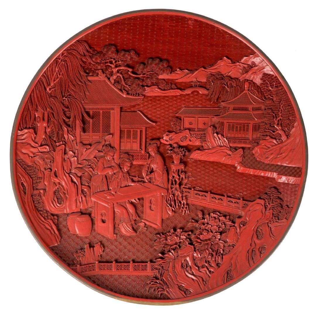 A large Chinese lacquer dish with a brass edge,