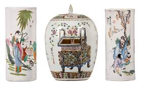 Two polychrome Chinese cylindrical vases decorated