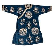 A Chinese silk embroidered robe, floral decorated, with