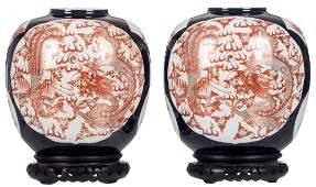 A pair of Chinese blue ground and gilt decorated vases