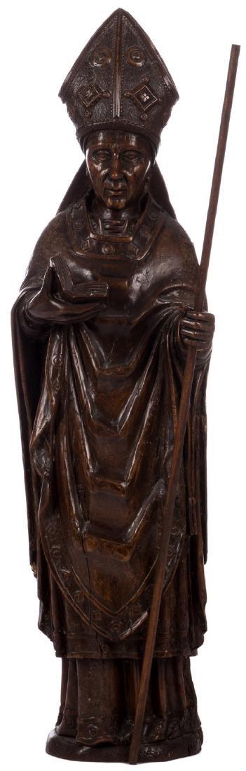 A sculpted walnut statue depicting a bishop, 16thC, H