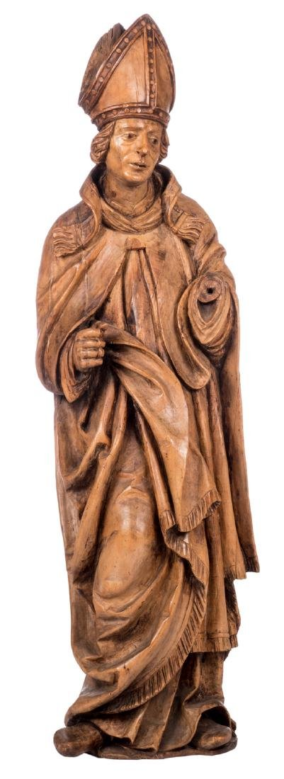 A statue of a Bishop, some traces op polychrome paint,