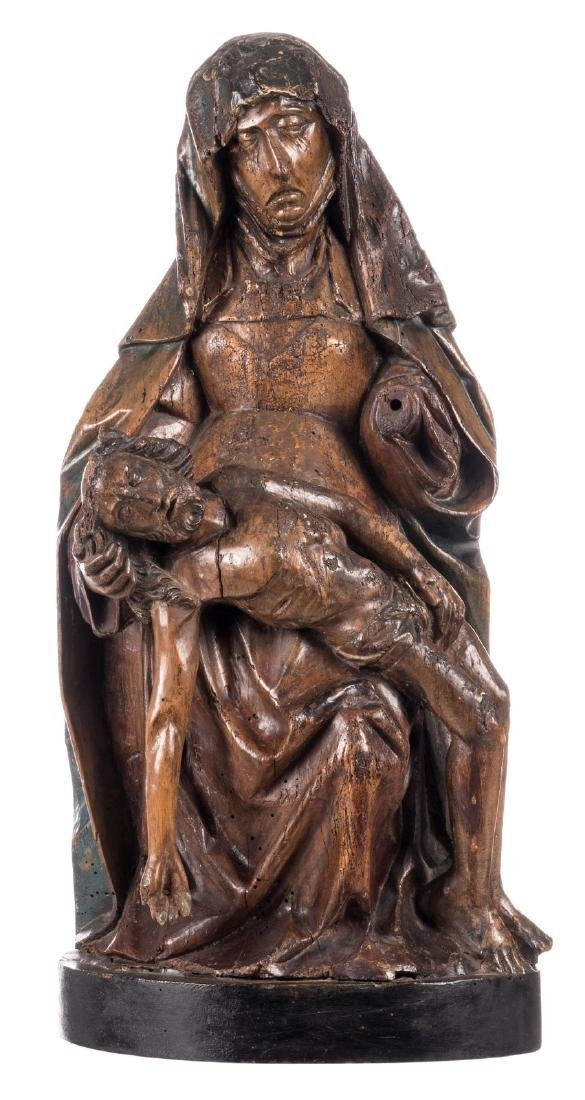 A carved wooden Pieta with traces of polyhrome paint,