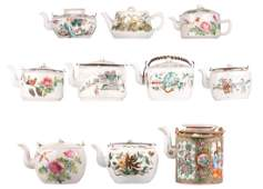 Nine Chinese famille rose decorated tea pots and covers