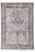 An Oriental rug with floral motifs and animals, Tabriz,