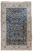 An Oriental rug decorated with various animals and