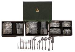 A cutlery storage chest with a twelve-piece silver