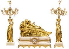 An exceptional French gilt bronze three-piece garniture