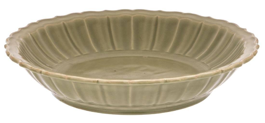 A large Chinese Longquan celadon barbed rim plate,