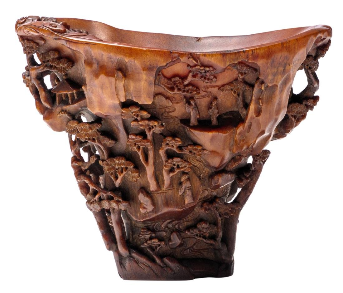 An extraordinary finely carved rhinoceros horn libation