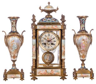 A Renaissance revival three-piece garniture, polychrome