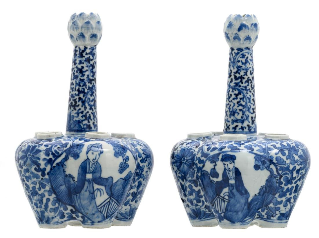 A pair of Chinese blue and white floral and relief
