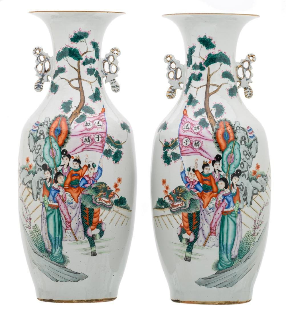 A pair of Chinese famille rose decorated vases with