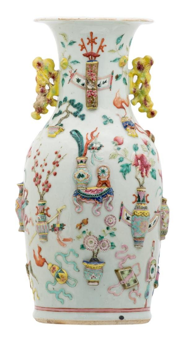 A Chinese famille rose and relief decorated vase with