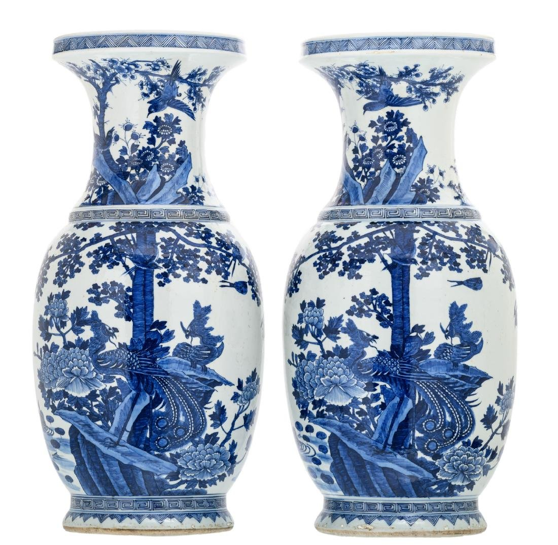 Two Chinese blue and white decorated vases with rocks,