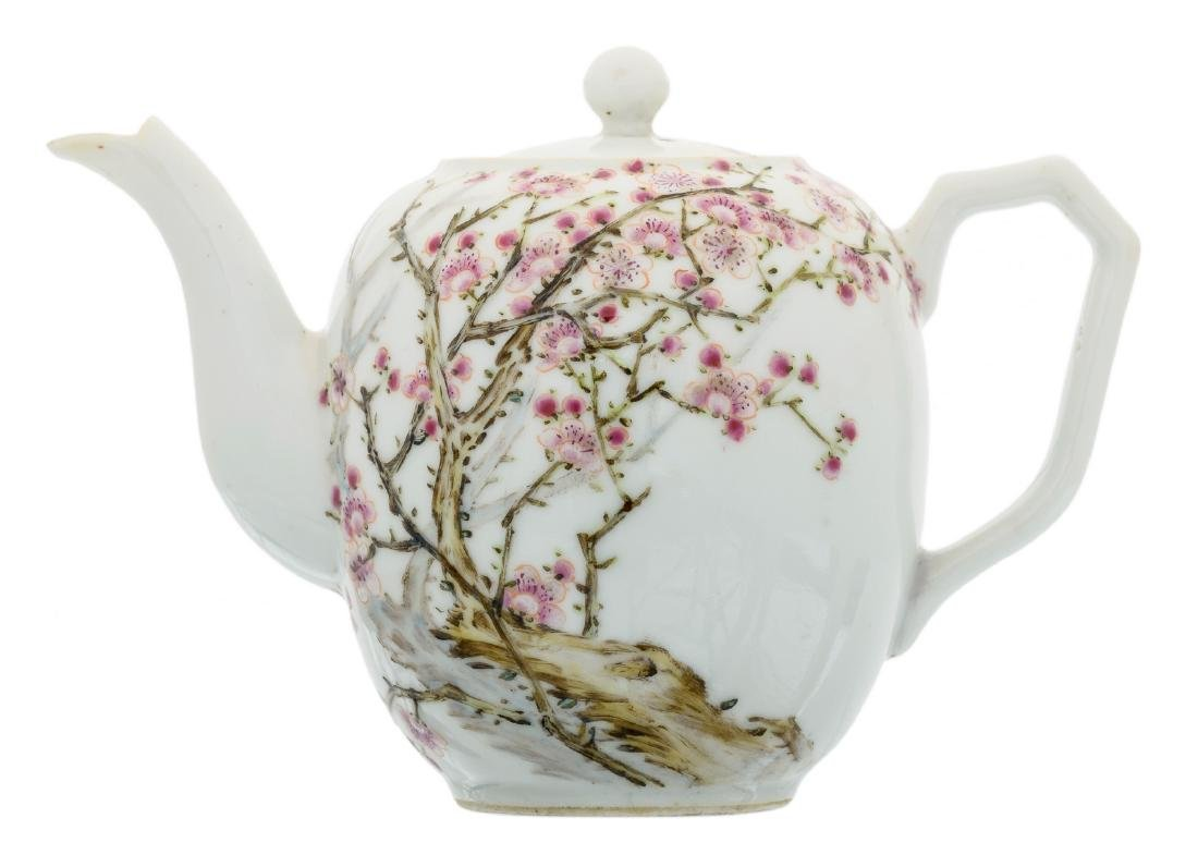 A Chinese famille rose teapot and cover, decorated with
