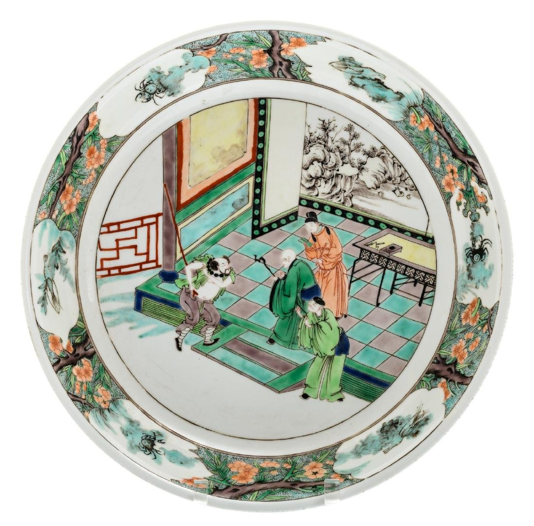 A Chinese famille verte plate decorated with an