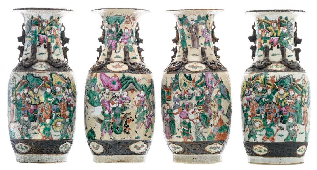 A pair of Chinese polychrome decorated stoneware vases