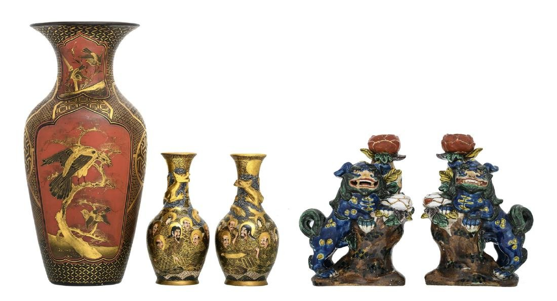 A Japanese red lacquered and gilt decorated vase, the