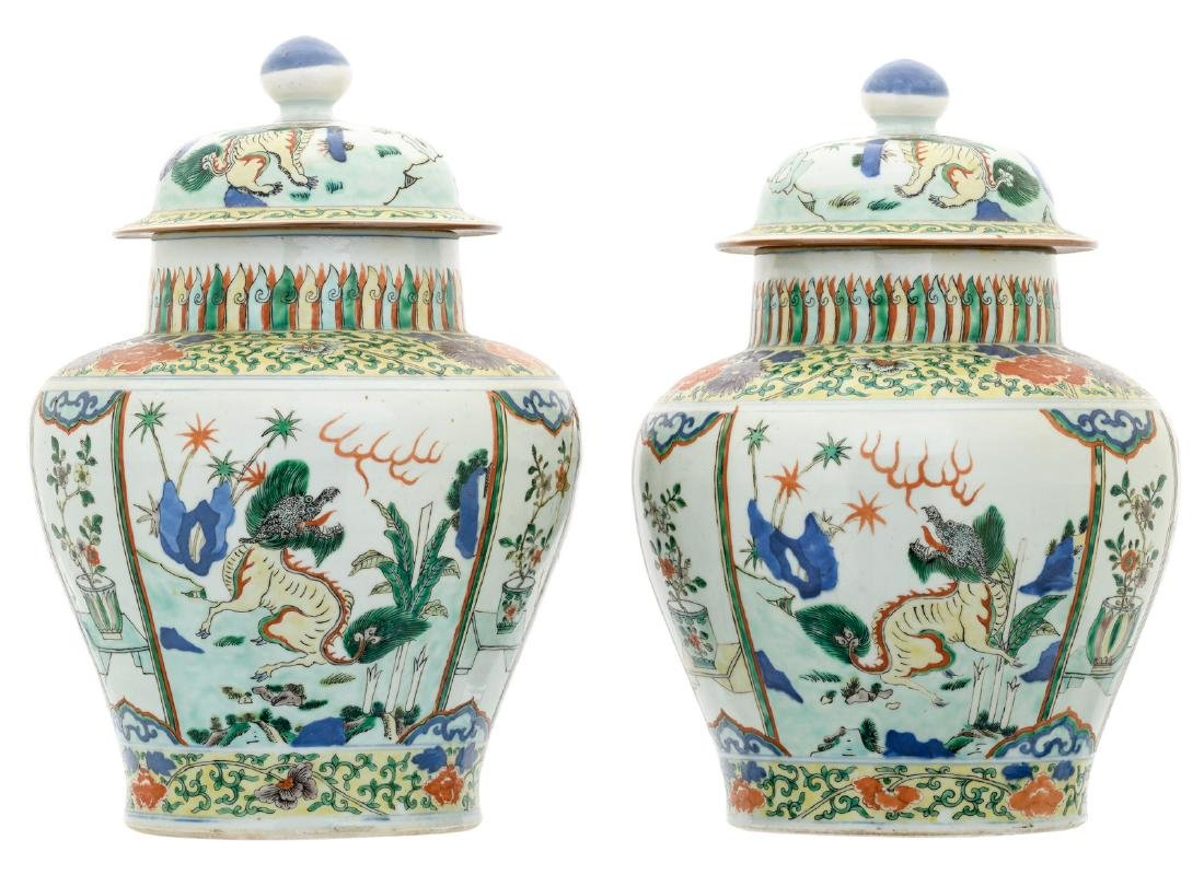 A pair of Chinese wucai overall floral decorated vases