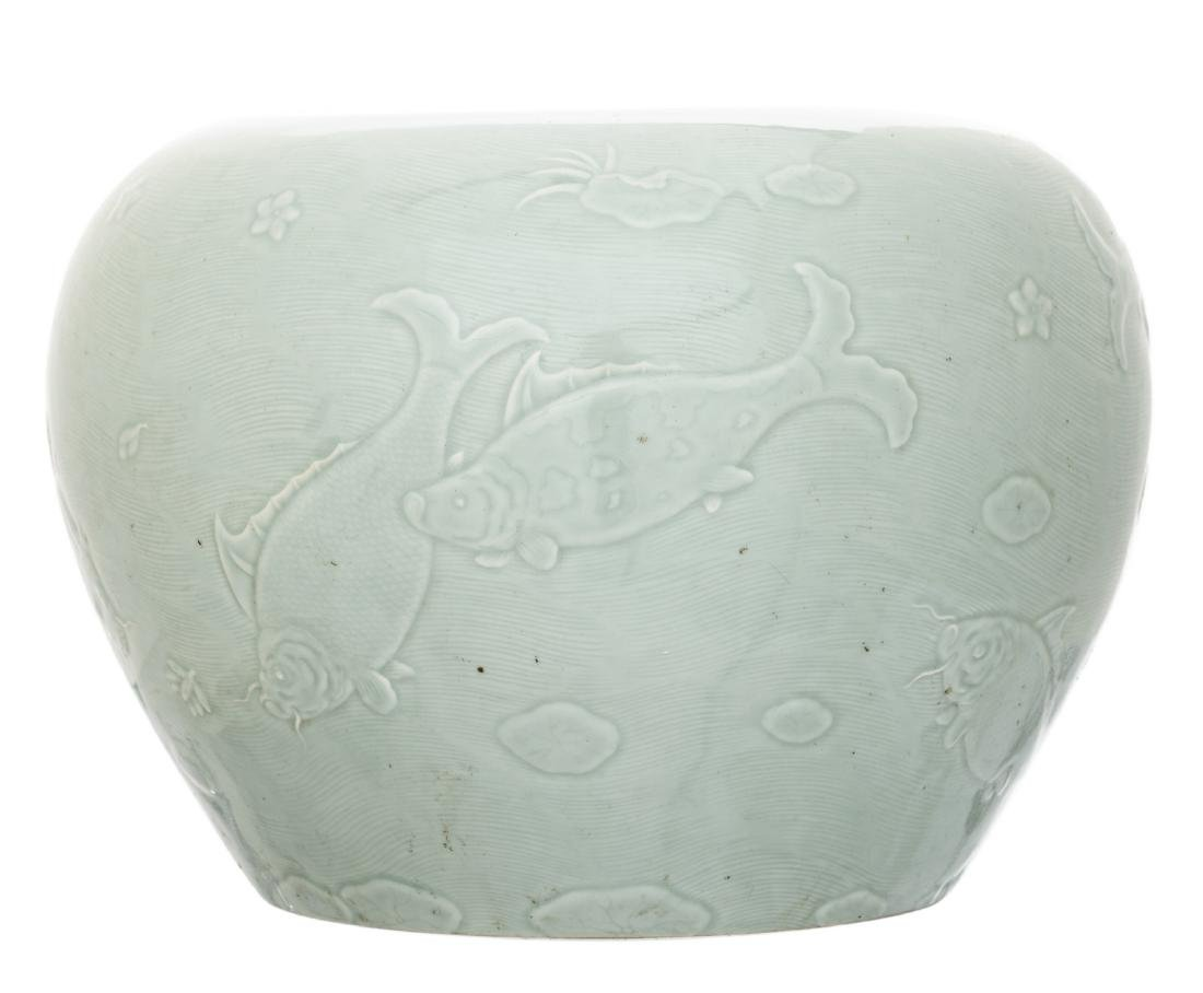 A Chinese celadon bowl, overall relief decorated with