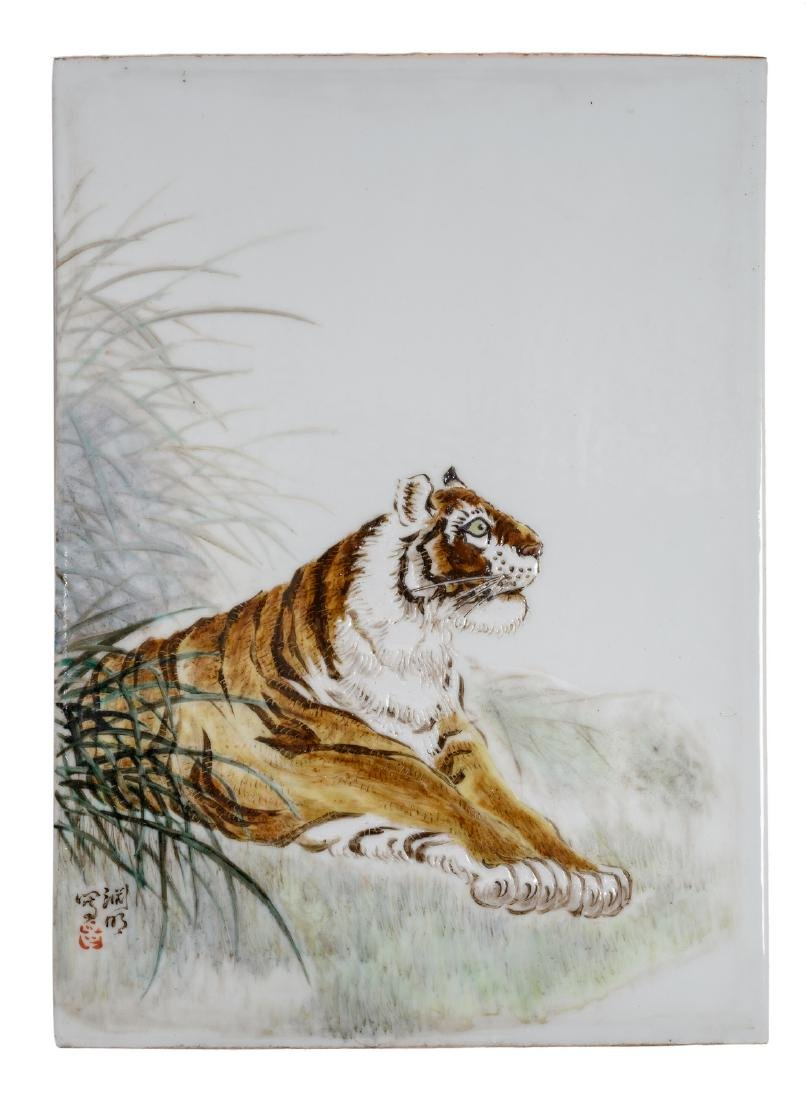 A Chinese polychrome decorated plaque with a tiger in a