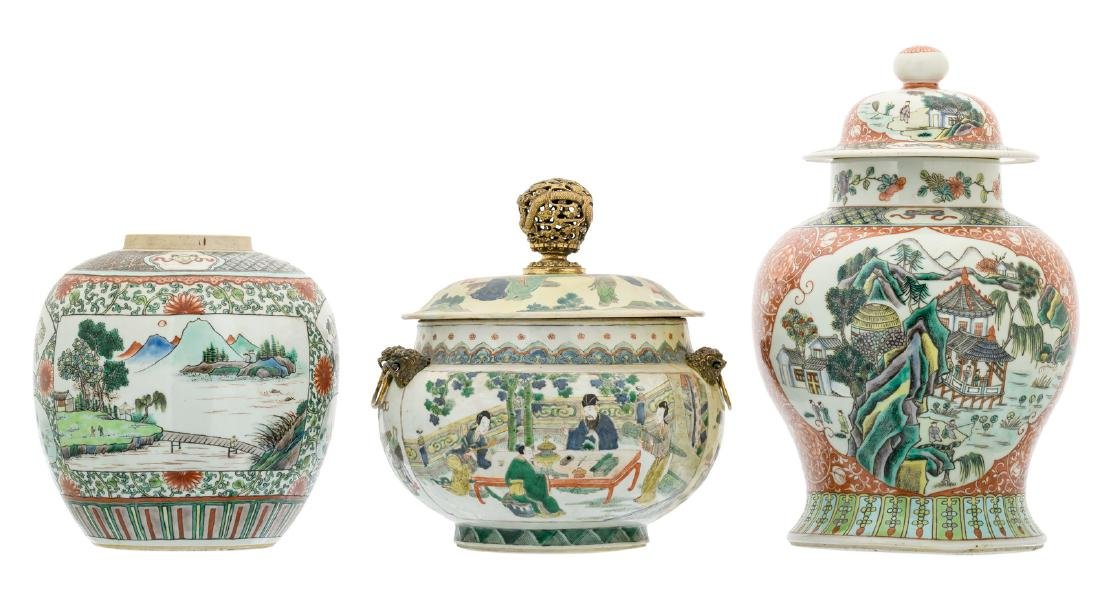 A Chinese famille verte floral decorated vase and cover