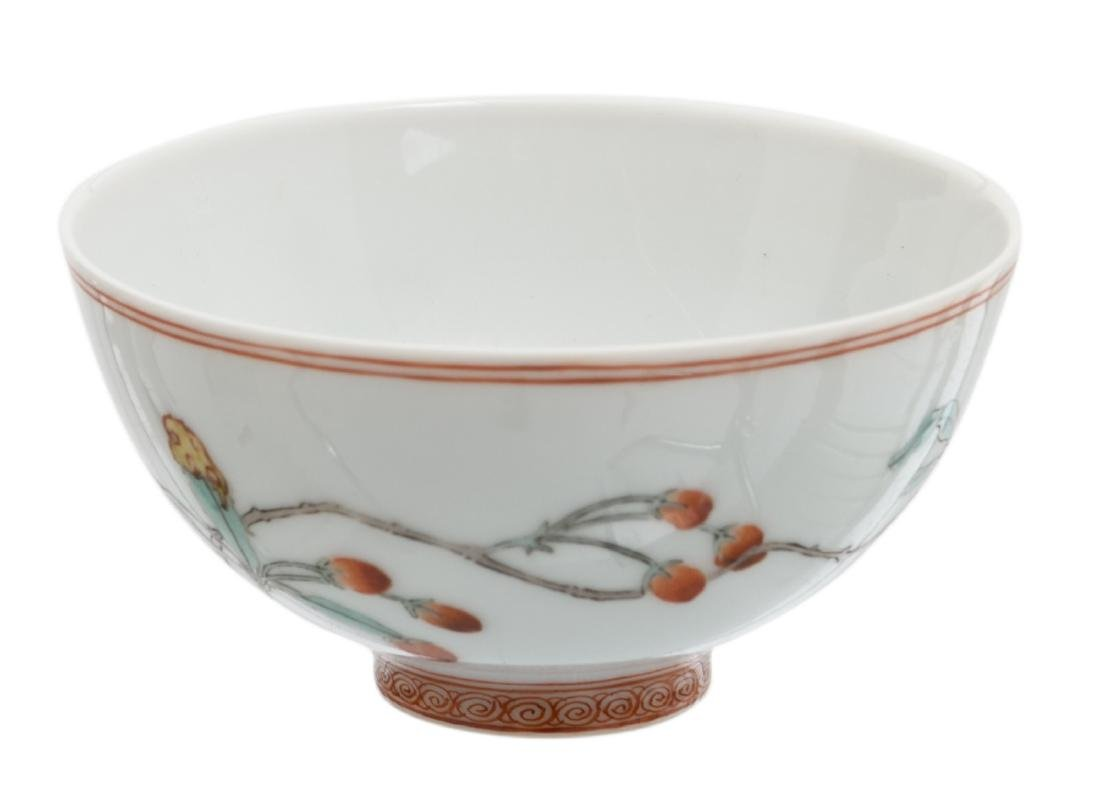 A Chinese polychrome decorated cup with butterflies and